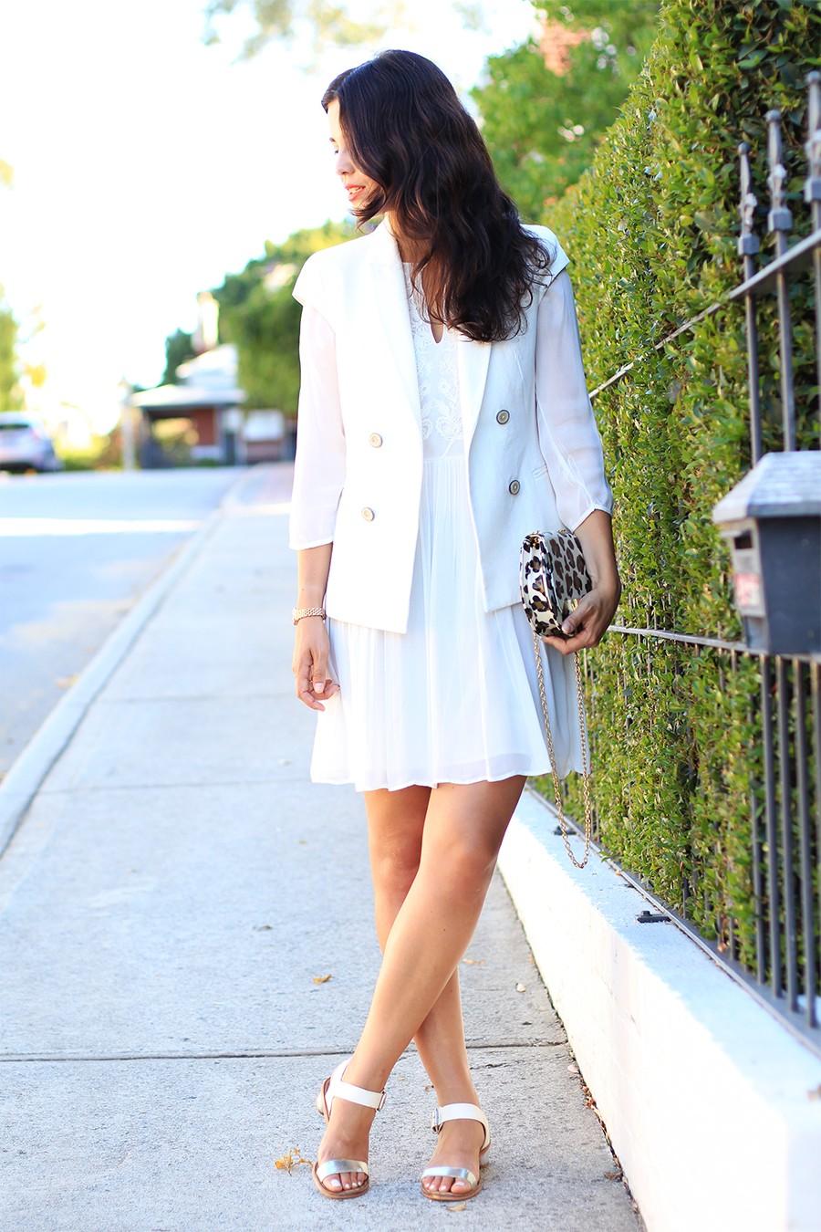 white-sleeveless-jacket
